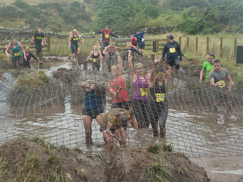 Wade your way through mud and water, while trying to traverse enormous balls of hay.